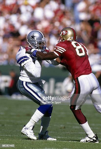 Defensive back Dion Sanders of the Dallas Cowboys plays guarding wide receiver Terrell Owens of the San Francisco 49ers November 10 1996 during an...