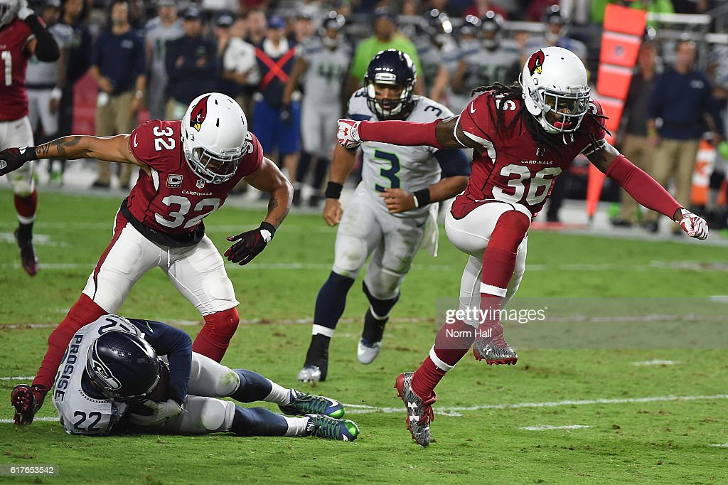 Defensive back D.J. Swearinger #36 and free safety Tyrann Mathieu #32 of the Arizona Cardinals celebrate after a tackle made on running back C.J. Prosise #22 of the Seattle Seahawks during the game at University of Phoenix Stadium on October 23, 2016 in Glendale, Arizona. The Seattle Seahawks and Arizona Cardinals tied 6-6.
