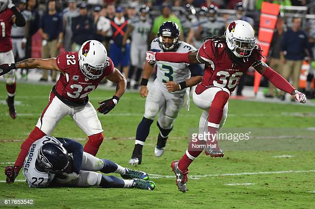 Defensive back DJ Swearinger and free safety Tyrann Mathieu of the Arizona Cardinals celebrate after a tackle made on running back CJ Prosise of the...