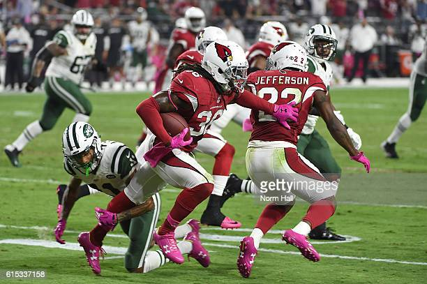 Defensive back DJ Swearinger of the Arizona Cardinals runs the ball after intercepting a pass in the end zone during the fourth quarter of the NFL...
