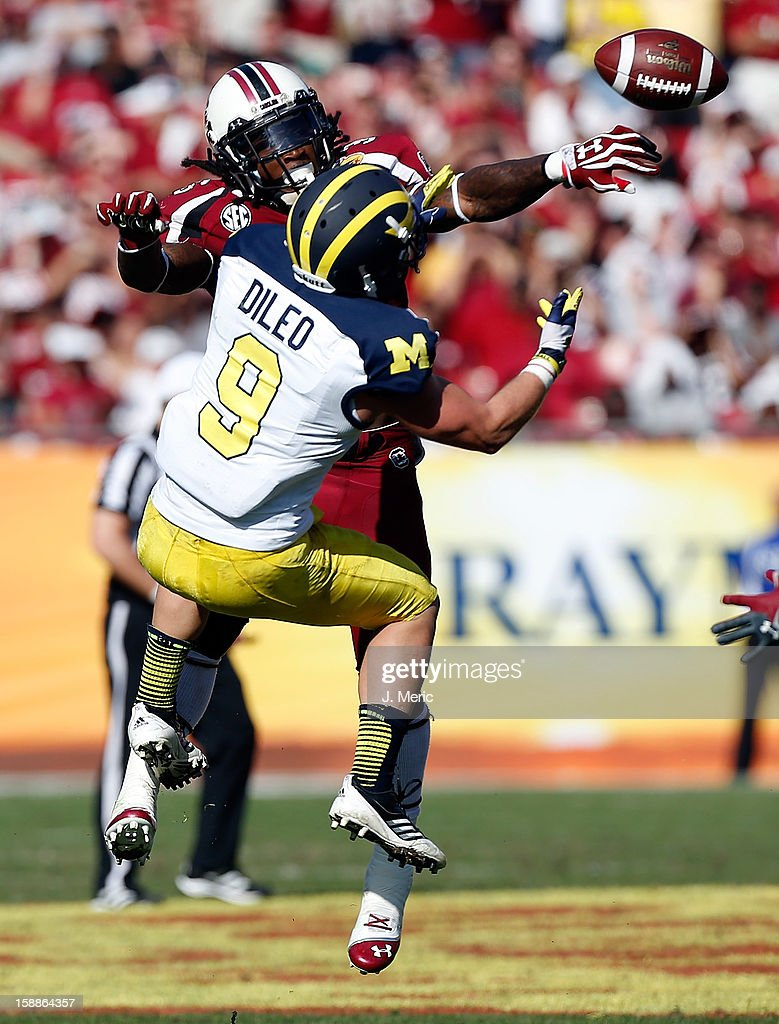 Defensive back D.J. Swearinger #36 of the South Carolina Gamecocks breaks up a pass intended for receiver Drew Dileo #9 of the Michigan Wolverines during the Outback Bowl Game at Raymond James Stadium on January 1, 2013 in Tampa, Florida.