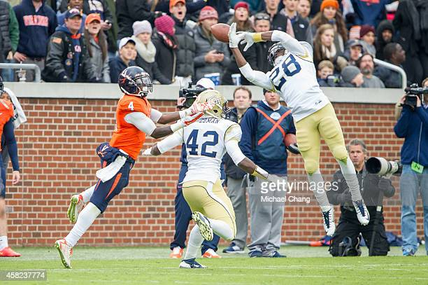 Defensive back D.J. White of the Georgia Tech Yellow Jackets attempts to intercept a pass intended for running back Taquan Mizzell of the Virginia...