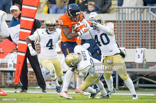 Defensive back D.J. White of the Georgia Tech Yellow Jackets attempts to tackle wide receiver Keeon Johnson of the Virginia Cavaliers on November 1,...