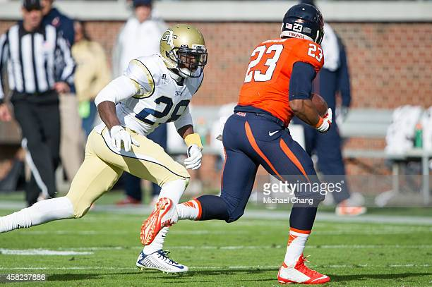 Defensive back D.J. White of the Georgia Tech Yellow Jackets looks to tackle running back Khalek Shepherd of the Virginia Cavaliers on November 1,...