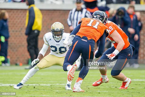 Defensive back D.J. White of the Georgia Tech Yellow Jackets looks to tackle quarterback Greyson Lambert of the Virginia Cavaliers on November 1,...