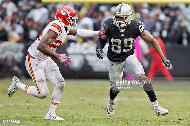 Defensive back D.J. White of the Kansas City Chiefs breaks up a pass with tight coverage against wide receiver Amari Cooper of the Oakland Raiders in...