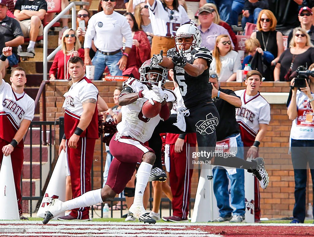Defensive back Donovan Wilson #6 of the Texas A&M Aggies intercepts a pass intended for wide receiver Gabe Myles #5 of the Mississippi State Bulldogs in the end zone during the second half of an NCAA college football game at Davis Wade Stadium on November 5, 2016 in Starkville, Mississippi.