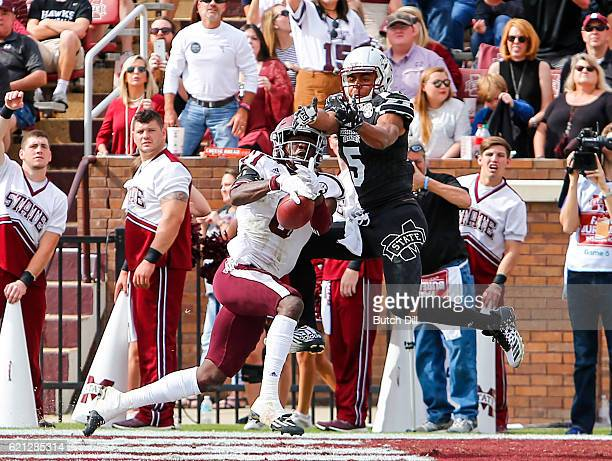 Defensive back Donovan Wilson of the Texas AM Aggies intercepts a pass intended for wide receiver Gabe Myles of the Mississippi State Bulldogs in the...