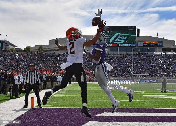 Defensive back Duke Shelley of the Kansas State Wildcats brakes up a pass for a two point conversion against wide receiver Tylan Wallace of the...