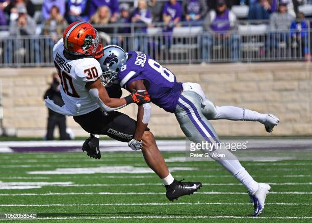 Defensive back Duke Shelley of the Kansas State Wildcats tackles running back Chuba Hubbard of the Oklahoma State Cowboys during the first half on...