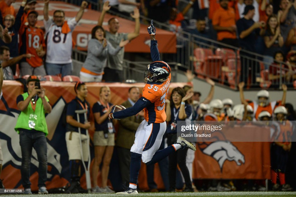Defensive back Dymonte Thomas #35 of the Denver Broncos celebrates in the end zone after intercepting a pass for a pick six touchdown in the second quarter during a preseason NFL game at Sports Authority Field at Mile High on August 31, 2017 in Denver, Colorado.