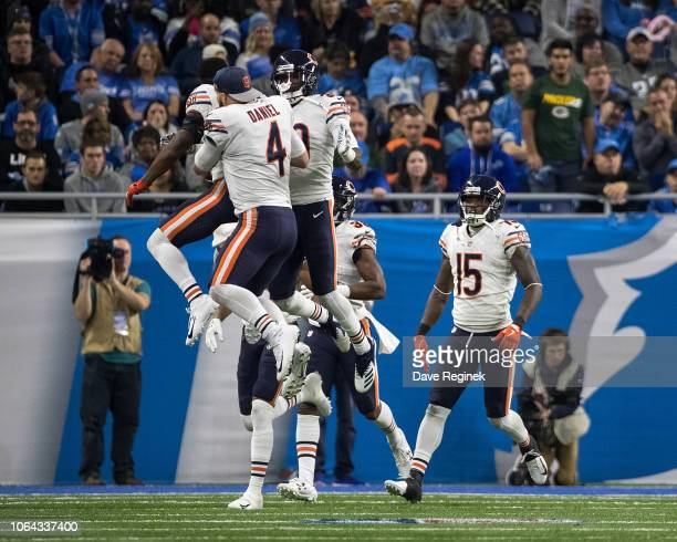 Defensive back Eddie Jackson of the Chicago Bears celebrates his interception for a touchdown in the fourth quarter with teammates quarterback Chase...