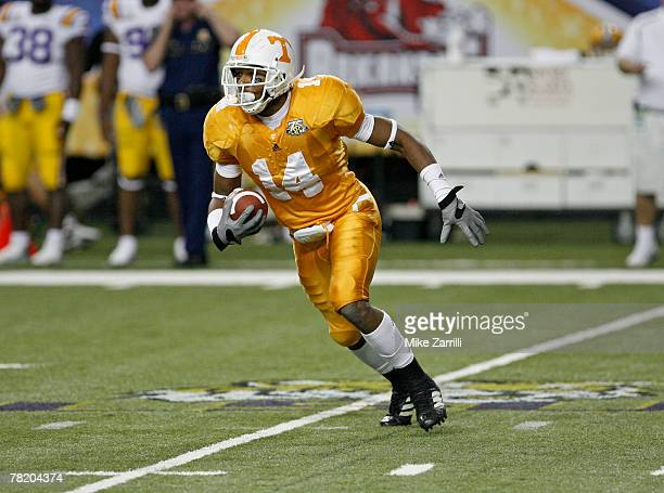Defensive back Eric Berry of the Tennessee Volunteers makes an interception and runs it upfield during the SEC Championship game against the LSU...