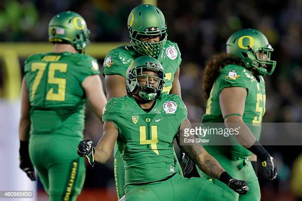 Defensive back Erick Dargan of the Oregon Ducks celebrates an interception against the Florida State Seminoles during the College Football Playoff...
