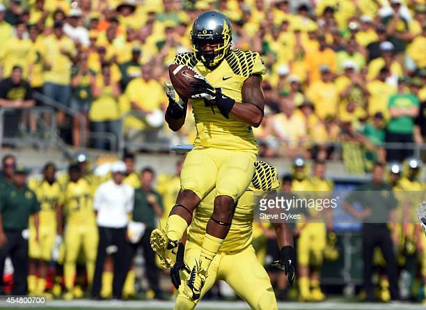 Defensive back Erick Dargan of the Oregon Ducks intercepts in the first quarter of the game against the Michigan State Spartans at Autzen Stadium on...