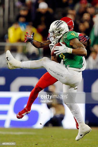 Defensive back Erick Dargan of the Oregon Ducks pulls down an interception for a 24yard return on a pass intended for wide receiver Samajie Grant of...