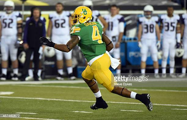 Defensive back Erick Dargan of the Oregon Ducks runs back an interception during the second quarter of the game against the Washington Huskies at...