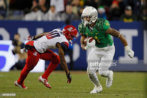 Defensive back Erick Dargan of the Oregon Ducks runs with an interception for a 24yard return on a pass intended for wide receiver Samajie Grant of...