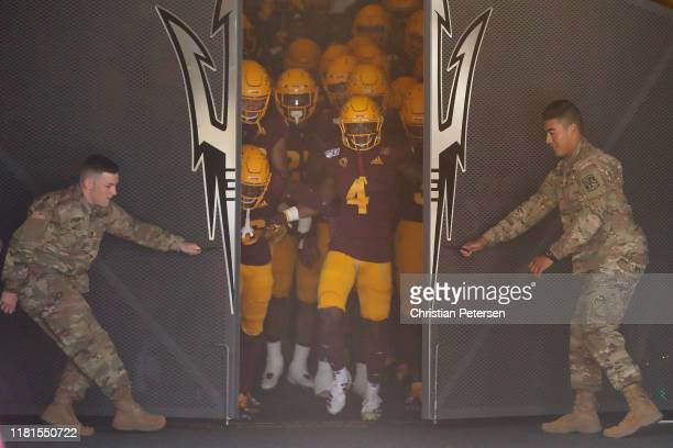 Defensive back Evan Fields of the Arizona State Sun Devils leads teammates out onto the field before the NCAAF game against the Washington State...