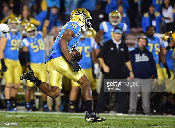 Defensive back Fabian Moreau of the UCLA Bruins returns his interception during the second quarter against the USC Trojans at Rose Bowl on November...