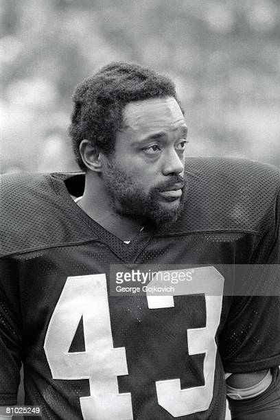 Defensive back George Atkinson of the Oakland Raiders looks on from the sideline during a game against the Cleveland Browns at Municipal Stadium on...
