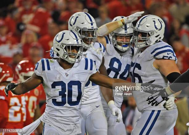 Defensive back George Odum of the Indianapolis Colts and his teammates celebrate as the defeat the Kansas City Chiefs against at Arrowhead Stadium on...