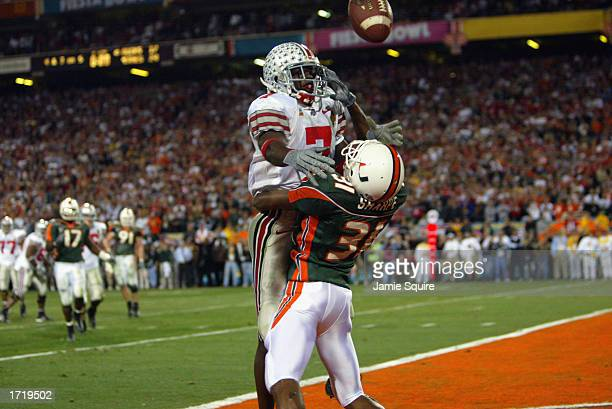 Defensive back Glenn Sharpe of the University of Miami Hurricanes is called for pass interference on the pass to Ohio State Buckeyes receiver Chris...