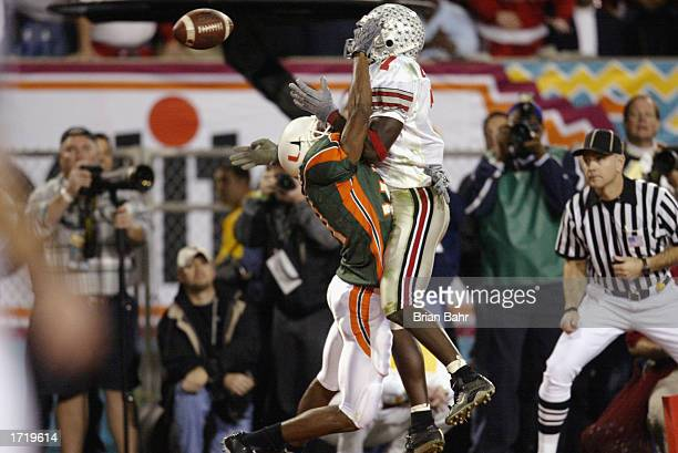 Defensive back Glenn Sharpe of the University of Miami Hurricanes is called for passinterference on Split end Chris Gamble of the Ohio State Buckeyes...