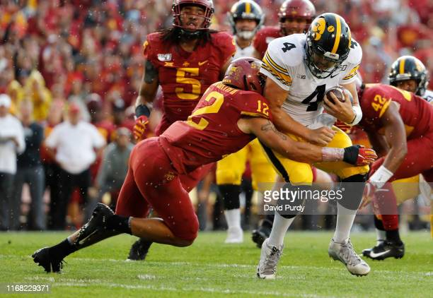 Defensive back Greg Eisworth of the Iowa State Cyclones sacks quarterback Nate Stanley of the Iowa Hawkeyes as he scrambled for yards in the first...