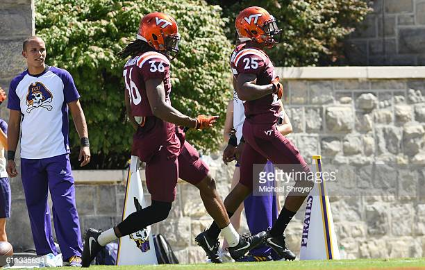 Defensive back Greg Stroman of the Virginia Tech Hokies celebrates his punt return touchdown against the East Carolina Pirates in the first half at...