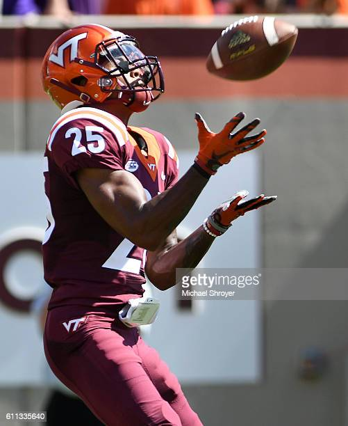 Defensive back Greg Stroman of the Virginia Tech Hokies fields a punt against the East Carolina Pirates in the first half at Lane Stadium on...