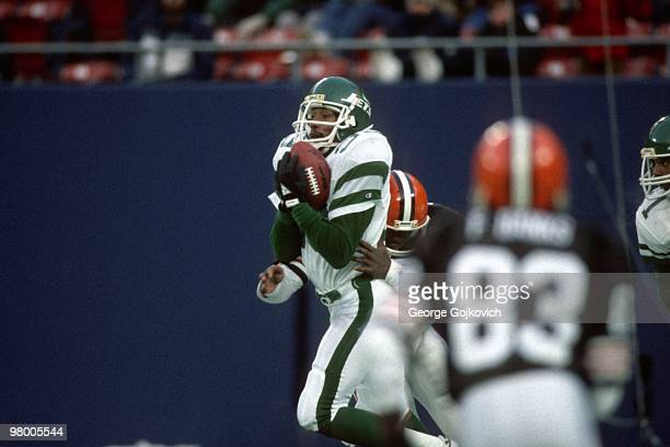 Defensive back Harry Hamilton of the New York Jets intercepts a pass during a game against the Cleveland Browns at Giants Stadium on December 22 1985...