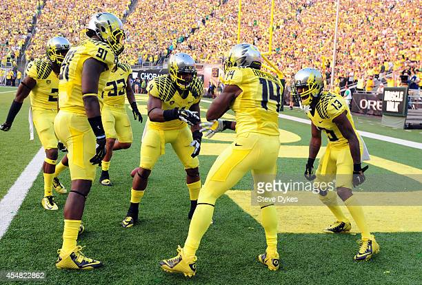 Defensive back Ifo EkpreOlomu of the Oregon Ducks celebrates with his teammates after intercepting a pass during the fourth quarter of the game...