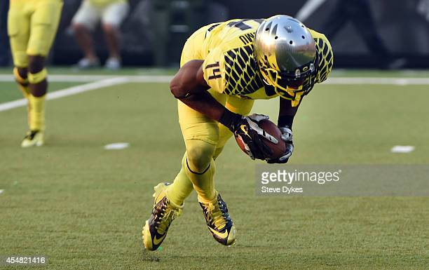Defensive back Ifo EkpreOlomu of the Oregon Ducks intercepts a pass during the fourth quarter of the game against the Michigan State Spartans at...