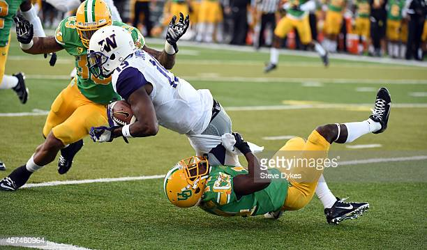 Defensive back Ifo EkpreOlomu of the Oregon Ducks tackles wide receiver DiAndre Campbell of the Washington Huskies during the second quarter of the...