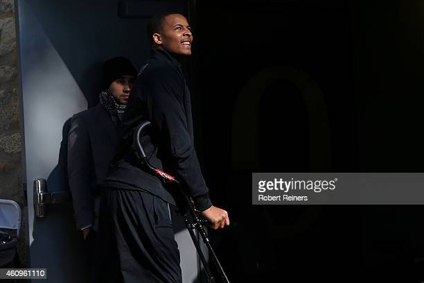 Defensive back Ifo EkpreOlomu of the Oregon Ducks walks on crutches towards the locker room prior to the College Football Playoff Semifinal at the...