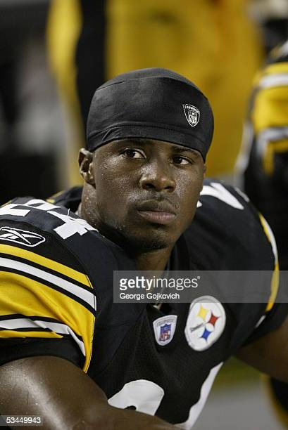 Defensive back Ike Taylor of the Pittsburgh Steelers watches the action from the bench during a preseason game against the Miami Dolphins at Heinz...