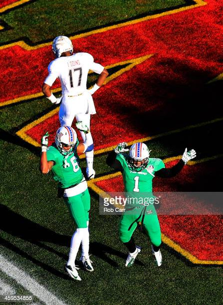 Defensive back Isaac Goins of the Maryland Terrapins walks away as Davonte Allen celebrates with wide receiver Tommy Shuler of the Marshall...