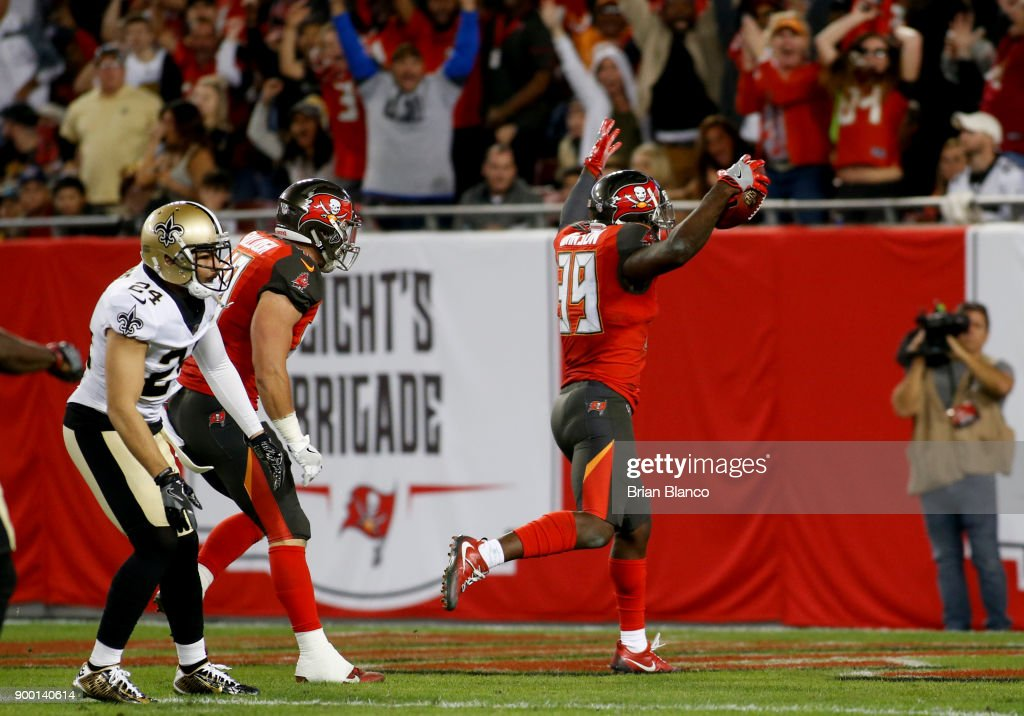 Defensive back Isaiah Johnson #39 of the Tampa Bay Buccaneers celebrates a touchdown against the New Orleans Saints on a seven-yard fumble recovery in the fourth quarter on December 31, 2017 at Raymond James Stadium in Tampa, Florida.