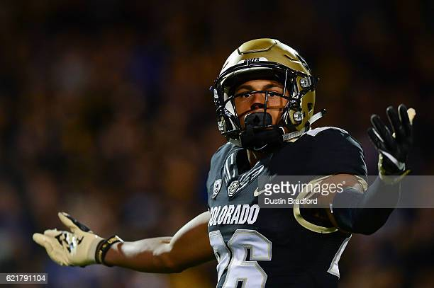 Defensive back Isaiah Oliver of the Colorado Buffaloes encourages the crowd to make noise during the first quarter of a game against the UCLA Bruins...