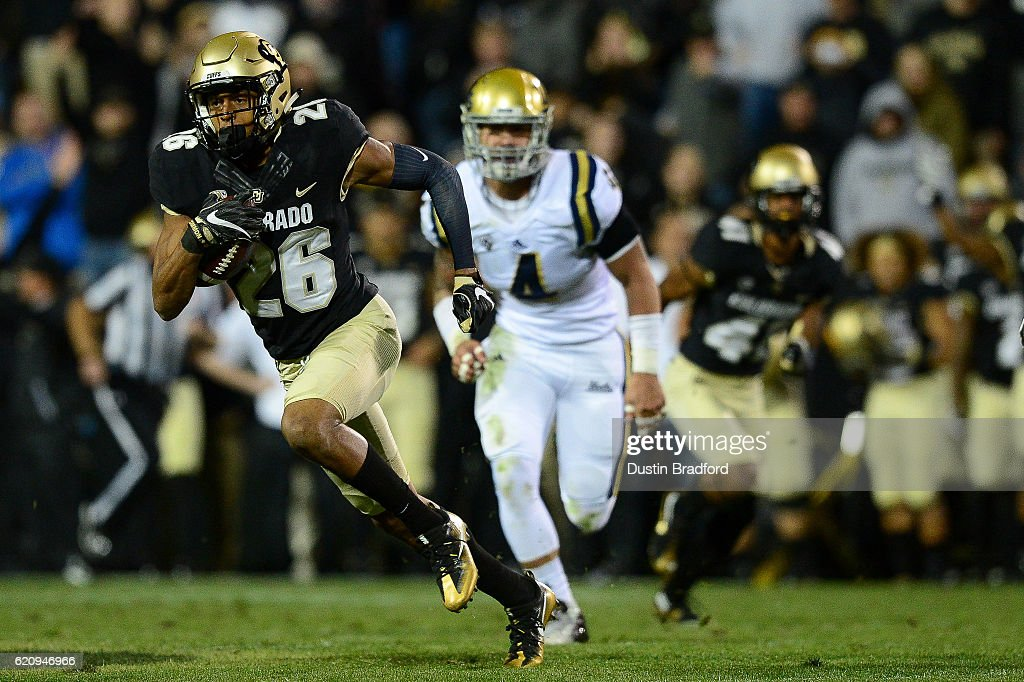 Defensive back Isaiah Oliver #26 of the Colorado Buffaloes returns a punt for yardage against the UCLA Bruins at Folsom Field on November 3, 2016 in Boulder, Colorado.