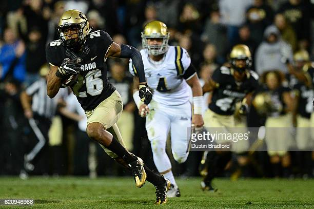 Defensive back Isaiah Oliver of the Colorado Buffaloes returns a punt for yardage against the UCLA Bruins at Folsom Field on November 3 2016 in...