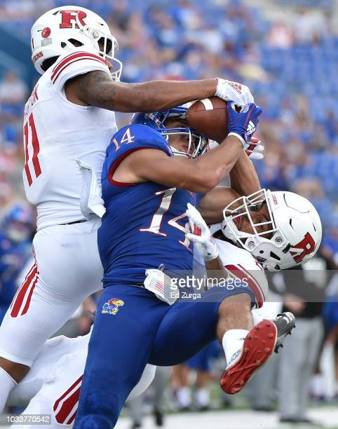 Defensive back Isaiah Wharton and Kiy Hester of the Rutgers Scarlet Knights break up a pass intended for wide receiver Kerr Johnson Jr #14 of the...