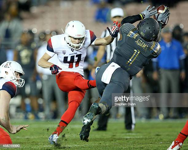 Defensive back Ishmael Adams of the UCLA Bruins blocks a field goal attempt by Casey Skowron of the Arizona Wildcats at the Rose Bowl on November 1...