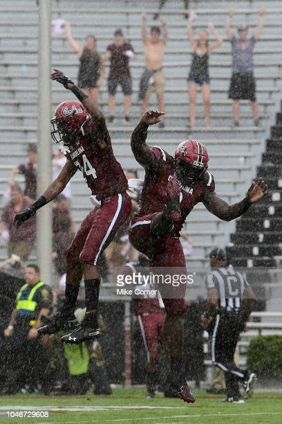 Defensive back Israel Mukuamu and defensive lineman Javon Kinlaw of the South Carolina Gamecocks celebrate after the Gamecocks score a touchdown off...