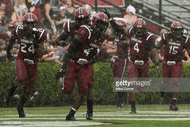 Defensive back Israel Mukuamu linebacker Bryson AllenWilliams linebacker TJ Brunson and defensive lineman Aaron Sterling run to the sidelines in...