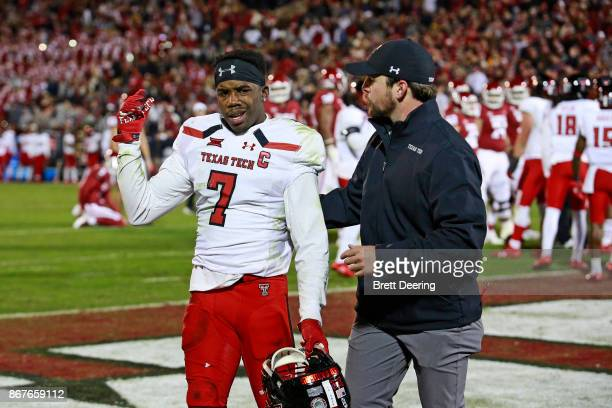 Defensive back Jah'Shawn Johnson of the Texas Tech Red Raiders leaves the field after receiving a targeting call during the game against the Oklahoma...