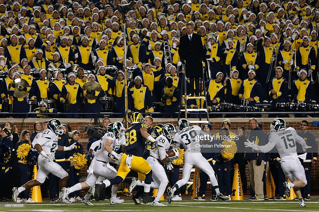 Defensive back Jalen Watts-Jackson #20 of the Michigan State Spartans runs the football into to end zone for the game winning touchdown against the Michigan Wolverines during the final seconds of college football game at Michigan Stadium on October 17, 2015 in Ann Arbor, Michigan. The Spartans defeated the Wolverines 27-23.