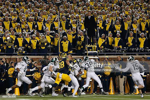 Defensive back Jalen WattsJackson of the Michigan State Spartans runs the football into to end zone for the game winning touchdown against the...