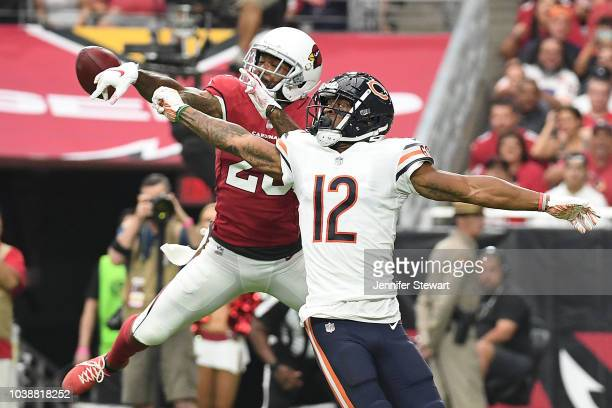 Defensive back Jamar Taylor of the Arizona Cardinals blocks a pass intended for wide receiver Allen Robinson of the Chicago Bears in the first half...